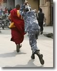 Policeman beats monk in Tibet protests