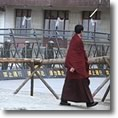 Monk walks past barricades in Gansu province