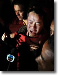 Tibetan monk cries as he talks to journalists