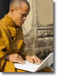 monk with laptop