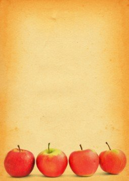 apples against old stained paper