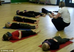 Primary school children being taught meditation techniques