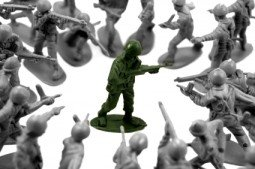 toy green army man surrounded