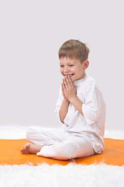 Children's yoga. The little boy does exercise.