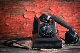 Old-fashioned rotary telephone off the hook