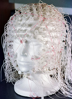 This geodesic sensor net containing 256 electrodes picks up electrical impulses from numerous parts of the brain when placed on a subject's head.