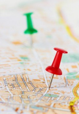 Red and green pushpin on a map
