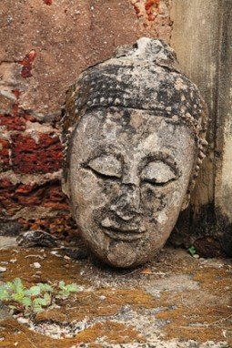 Ancient Buddha head without body in Sukhothai, Thailand