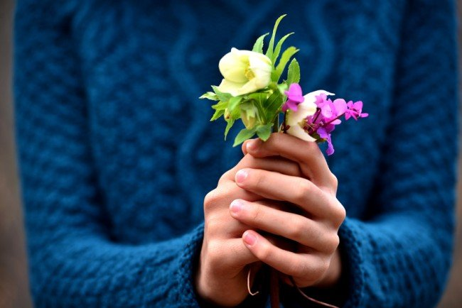 girl hand giving flowers