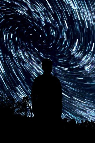 creativity: man surrounded by star trails