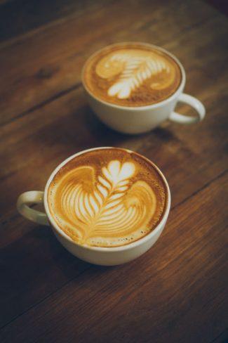 42111675 - coffee latte art in cofeee sbop vintage color tone